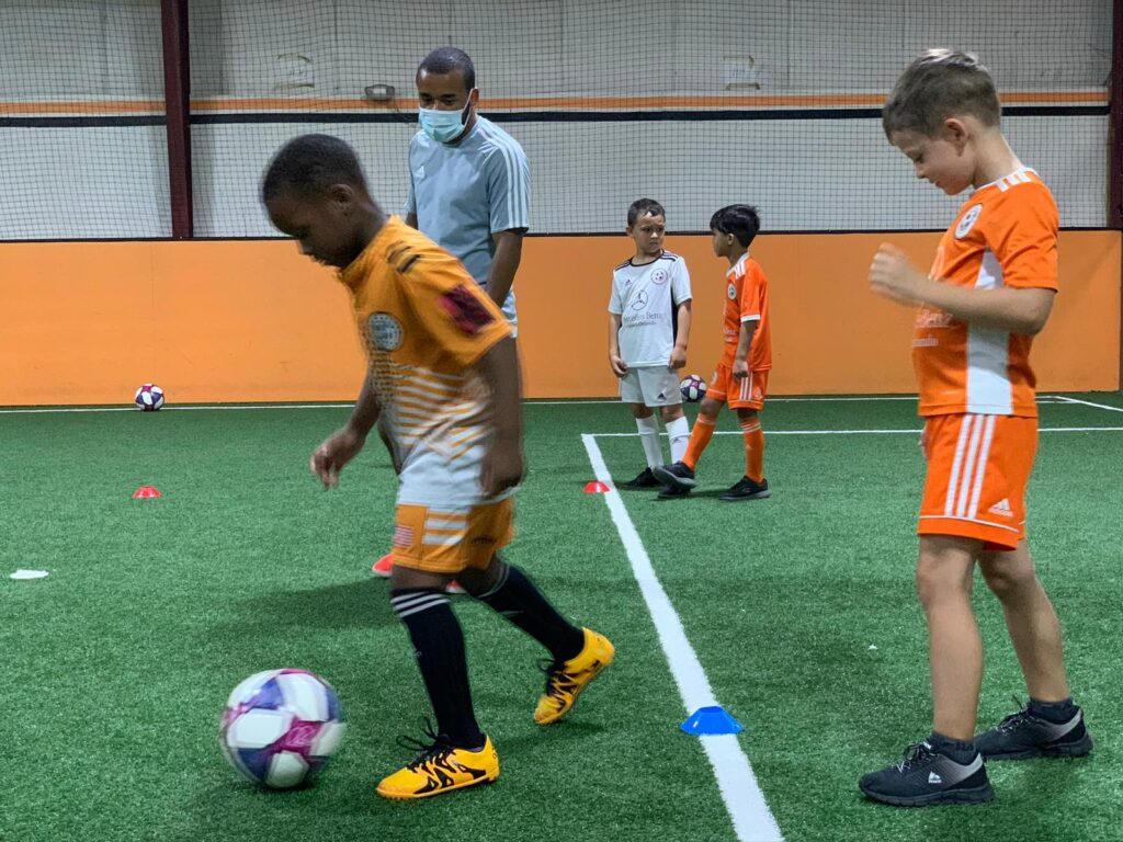 youth soccer class on turf